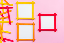 Blank Photo Frame Made Of Color Popsicle Wood Sticks On Pink Background