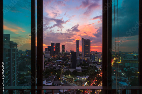 Glass window in room with view at beautiful sunset Fototapeta