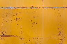 Rusted Yellow Bus Board Flat Background Closeup