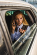 Portrait of girl talk by cellphone, sit in car