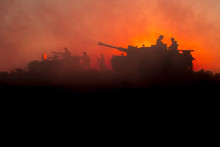 War Concept. Military Silhouettes Fighting Scene. World War German Tanks And Soldiers Silhouettes At Sunset. Attack Scene. Armored Vehicles.