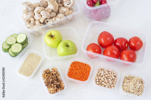 Storage of vegetarian food in plastic containers. Healthy eating. Order in the kitchen and in the fridge. Top view, flat lay