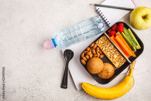 Fotobehang Assortiment Healthy meal prep containers with cereal bar, fruits, vegetables and snacks. Takeaway food on white background, top view.