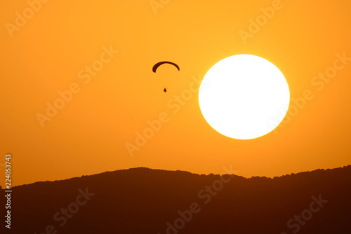 Paramotor pilot making a flight.
