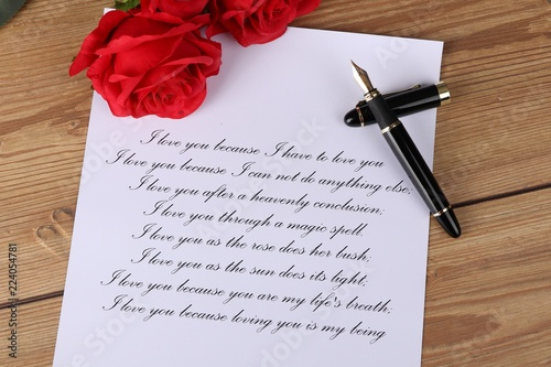 Fototapeta love letter - handwritten letter with a declaration of love with red roses on