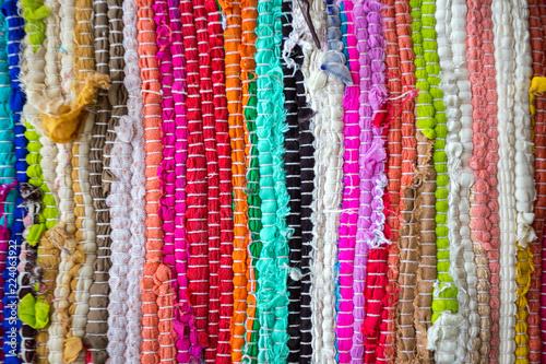 Valokuvatapetti brazil textiles background of bright rugs