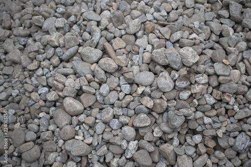 Fotografie, Obraz  pile of river rocks close up