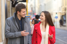 Happy Couple Walks In The Street Talking