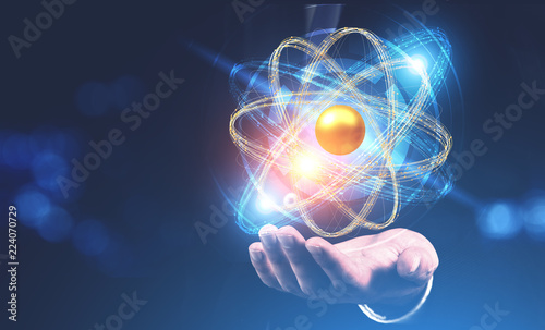 Man hand with hovering atom model hologram