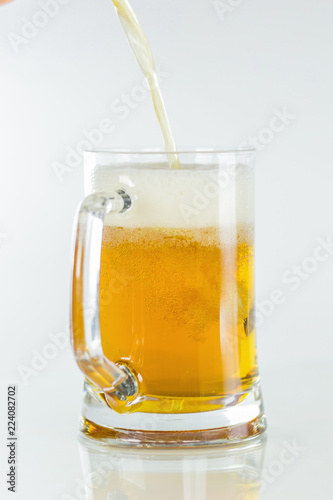 Fotobehang Alcohol Glass of beer on white background.