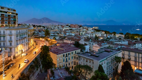 Fotobehang Napels Evening view of Naples, Italy and Gulf of Naples to Mount Vesuvius