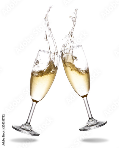 Carta da parati Cheers champagne with splashing out of glass isolated on white background