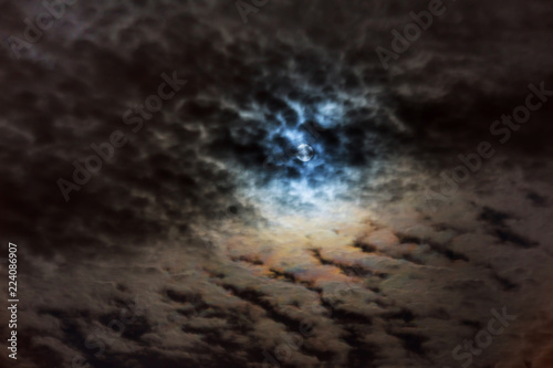 Foto op Plexiglas Nacht Mysterious night sky with full moon. Dramatic clouds in the moonlight from full moon.
