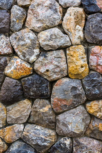 In de dag Stenen Background texture of stone wall.Background texture of stone wall. Natural stone, a wall of natural stone.