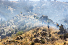 Firefighters Battle A Blaze Along The Mountains Near El Cajon Pass In Southern California