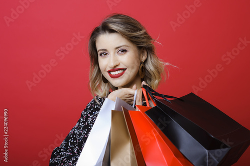 Photo  Young woman posing with shopping bags
