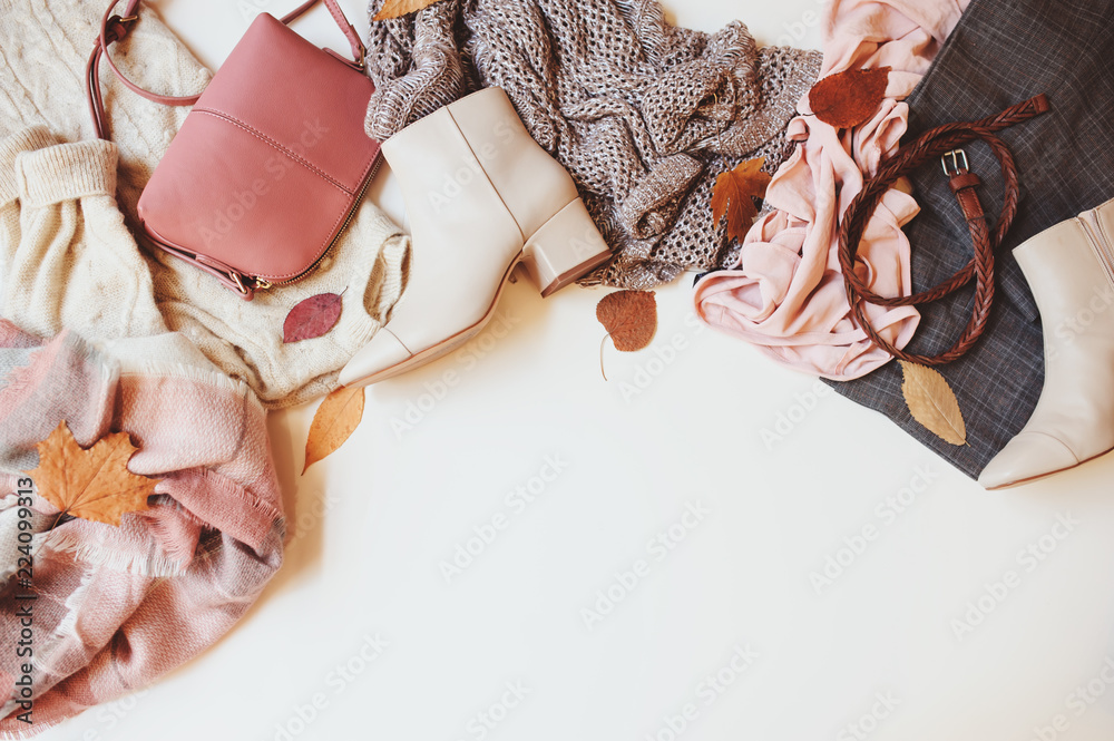 Fototapeta set of seasonal autumn fashion woman clothes, top view with copy space. Trendy shoes, sweater and handbag.