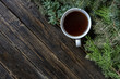 top view creative flat lay cup of tea near pine branches on a wooden surface f