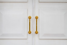 White Church Doors With Golden Handles. Closeup