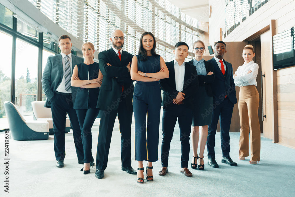 Fototapeta Successful team of young perspective businesspeople in office