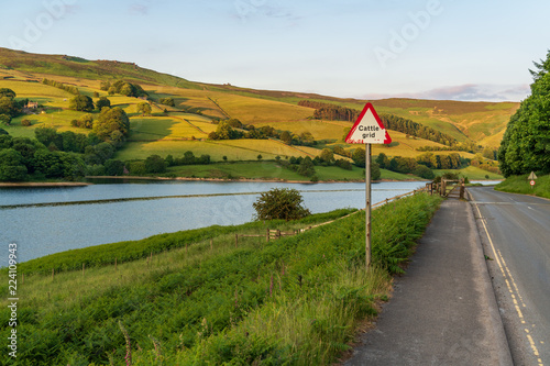 Fotografie, Obraz  Sign: Cattle Grid, seen at the Ladybower Reservoir near Bamford in the East Midl