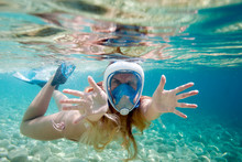 Woman Snorkeling With Full Face Mask In The Tropical Sea