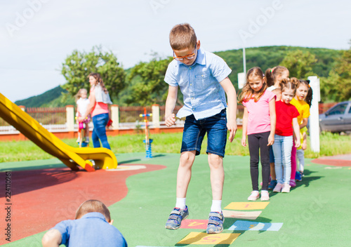 Entertaining physical education lesson in the summer outdoors Fototapeta
