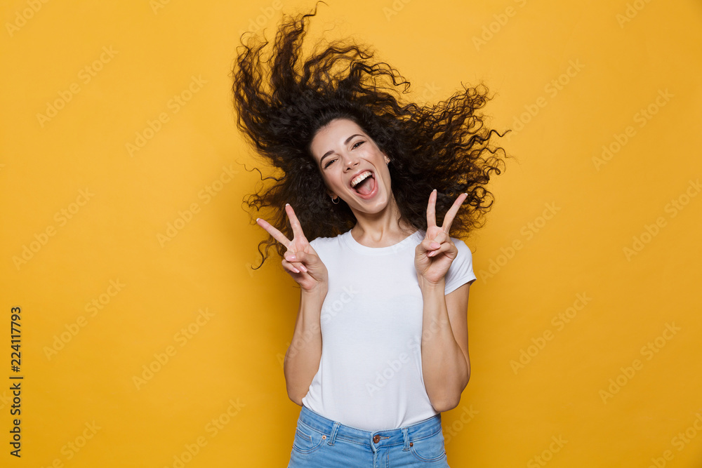 Fototapety, obrazy: Image of european woman 20s laughing and having fun with shaking hair, isolated over yellow background