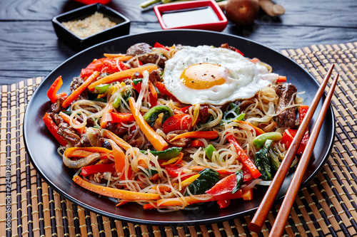 stir fried noodles with vegetables, beef, close up Canvas Print
