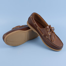 Men's Brown Moccasins, Loafers Isolated On Blue Background.