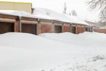 Huge Snow Banks Near Garage Do...