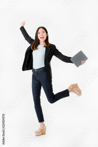 Photographie  Asian businesswoman in black suit joyful jumping with celebrating successful isolated on white background studio shot