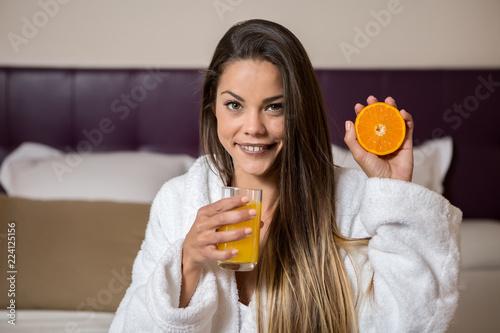 Foto op Aluminium Assortiment Woman in morning gown holding orange
