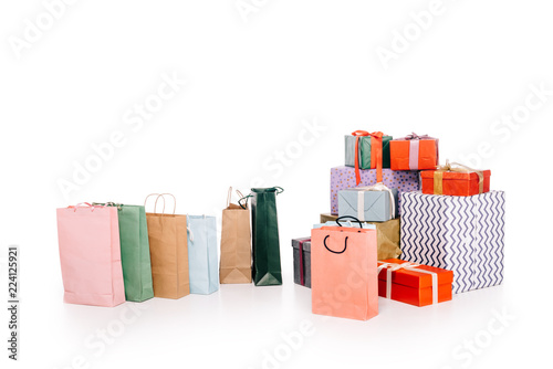 Fotografia  colorful shopping bags and various stacked gift boxes isolated on white