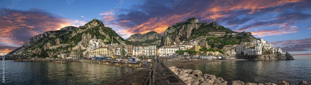 Fototapety, obrazy: Beautiful panorama of Amalfi, the main town of the coast on which it is located taken from the sea. Situated in province of Salerno, in the region of Campania, Italy, on the Gulf of Salerno at sunset