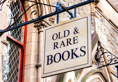 Photo AOld & Rare Books sign in front of some victorian architecture