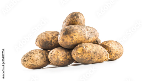 Ripe dirty potatoes isolated on white background