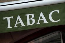 Closeup Of Green Tabacco Store Front With French Text Tabac, The Traduction In English Of Tobacco