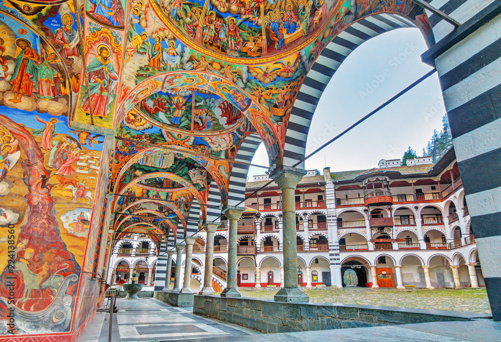 Fototapety, obrazy: Beautiful view of the vibrant decoration of the Orthodox Rila Monastery, a famous tourist attraction and cultural heritage monument in the Rila Nature Park mountains in Bulgaria