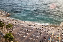Top View Of The Illuminated By The Setting Rays Of The Sun The Beach On The Adriatic Sea In The Town Of Dobra Voda, Montenegro