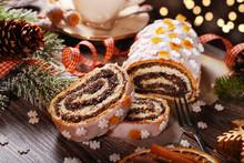 Christmas Poppy Cake On Wooden Table