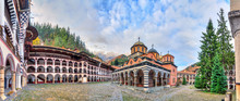 Beautiful Panoramic Panorama Of The Orthodox Rila Monastery, A Famous Tourist Attraction And Cultural Heritage Monument In The Rila Nature Park Mountains In Bulgaria