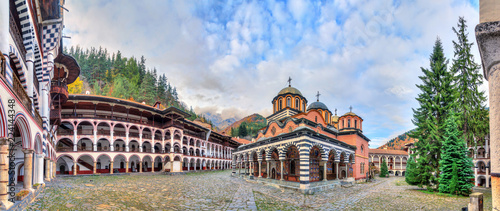 Garden Poster Old building Beautiful panoramic panorama of the Orthodox Rila Monastery, a famous tourist attraction and cultural heritage monument in the Rila Nature Park mountains in Bulgaria