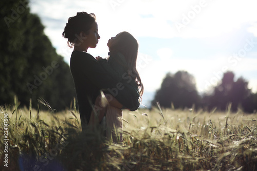 A young mother walk in wheat fields Canvas Print