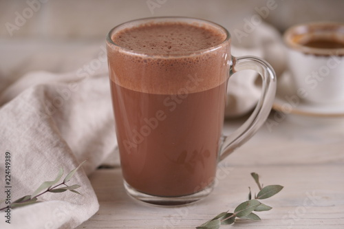Glass mug with cocoa