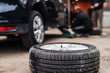 Picture of car tire in workshop. Tire installation. Car service. Auto mechanic workshop.