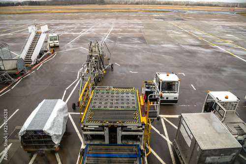 Bag Cart and other Equipment for loading and unloading aircraft on the Tarmac of an Airport on a Winter Morning