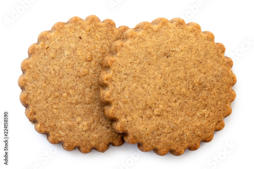 Valokuva  Two round gingerbread biscuits isolated on white from above