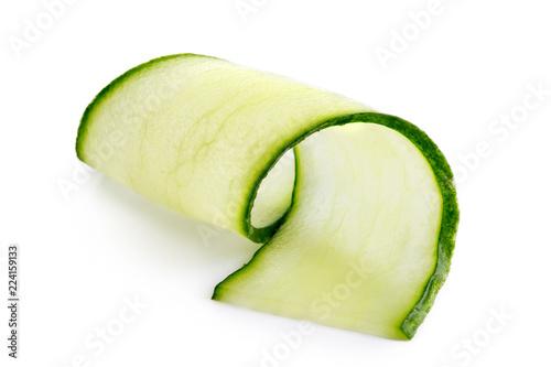 Fotografía  Thin cucumber twirl isolated on white.