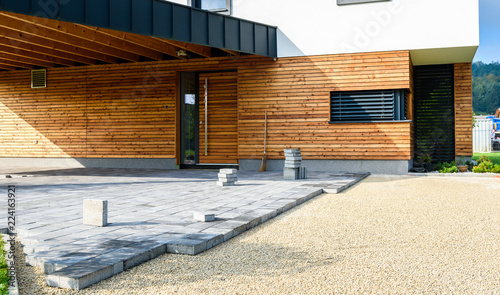 Laying gray concrete paving slabs in house courtyard driveway patio Canvas